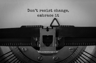 Text Do not resist change embrace it typed on retro typewriter